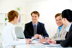 Business briefing. Portrait of four business people sitting at the boardroom during briefing Stock Images