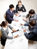 Business briefing. Team of five business people discussing an important question at briefing Royalty Free Stock Images