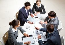 Business briefing. Team of five business people discussing an important question at briefing Stock Images