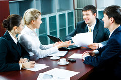 Business briefing. Photo of four business people discussing questions at briefing Royalty Free Stock Images