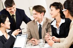 Business briefing. Portrait of five business people discussing a project at briefing Royalty Free Stock Image