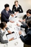 Business briefing. Team of five business people discussing an important question at briefing Royalty Free Stock Photos