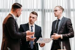 Business briefing leadership team boss discussion. Business briefing. leadership. boss talking to his team in office discussing results and giving instructions Royalty Free Stock Image
