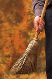 Business broom sweeps clean. Concept businessman holds broom for sweeping corporate business clean Royalty Free Stock Images