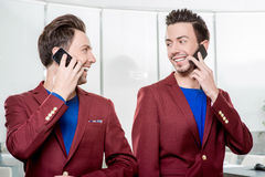 Business brothers twins with phones Royalty Free Stock Photos
