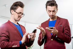 Business brothers twins with phones Stock Image