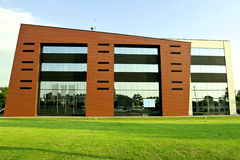 Business building. Modern business building exterior with grass Royalty Free Stock Photography