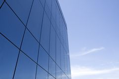Business building. A business building made of reflecting windows. Is taken on a sunny day Royalty Free Stock Photography