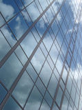 Business building. Sky reflection on a modern business building glass facade royalty free stock photos