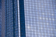 Business Building. Detail, reflections on a glass wall royalty free stock photo