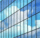 Business building abstract background vision. Business building, abstract background of glass facade with cloud reflection as a symbol for vision of success Royalty Free Stock Image