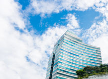 Business building against the blue sky. And beautiful clouds Royalty Free Stock Photography