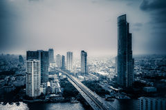 Business Building Bangkok city area at twilight scene with trans. Portation car and ship as panorama, high angle bird eyes view royalty free stock photography