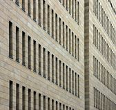 Business building facade. Facade of a modern business building with lots of thin windows Royalty Free Stock Photo