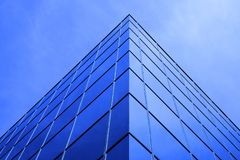 Business Building Highrise Mirrored Windows with Sky and Clouds Stock Photos