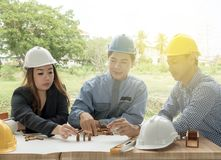 Business, building, teamwork and people concept - group are discussing the project building plan with his business client.  stock photos