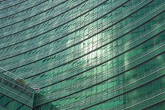 Business Building. Transparent glass windows of office building with reflections Stock Image