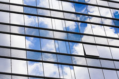 Business Building. Transparent glass windows of office building with reflections Royalty Free Stock Image