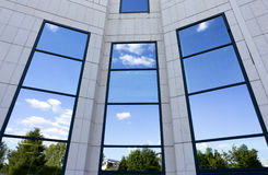 Business building windows reflections Stock Images