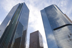 Business buildings. Downtown Los Angeles, three buildings reflecting clouds Royalty Free Stock Photography