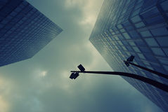 Business buildings. Business modern architecture under the dark clouds Royalty Free Stock Photos