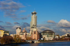 Business buildings near river Stock Photography