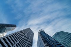Business buildings skyline looking up with blue sky. Business downtown and skyscrapers, high-rise buildings, modern architecture buildings Royalty Free Stock Photos