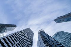 Business buildings skyline looking up with blue sky. Business downtown and skyscrapers, high-rise buildings, modern architecture buildings Royalty Free Stock Image