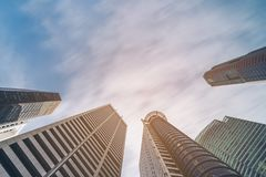 Business buildings skyline looking up with blue sky. Business downtown and skyscrapers, high-rise buildings, modern architecture buildings Royalty Free Stock Images