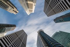 Business buildings skyline looking up with blue sky. Business downtown and skyscrapers, high-rise buildings, modern architecture buildings Royalty Free Stock Photo