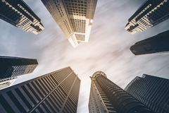 Business buildings skyline looking up with blue sky. Downtown and skyscrapers, high-rise buildings, modern architecture Royalty Free Stock Image