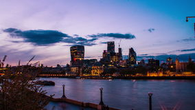 Business buildings and Thames River, London, Uk, day to night, time lapse, 4k stock video footage