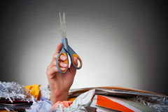 Business: Buried Hand Holding Scissors Stock Photo