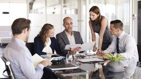 business businessman cmputer desk laptop meeting smiling talking to using woman