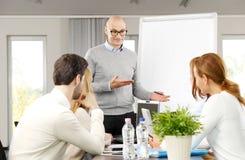 business businessman cmputer desk laptop meeting smiling talking to using woman Στοκ Εικόνα