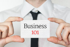 Business 101. Businessman holding business card Stock Photography