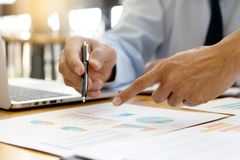 Business businessman in meeting analyses chart graphy. Marketing plan in business financial  audit project. Or Business adviser analyzing, budget, consultant stock images