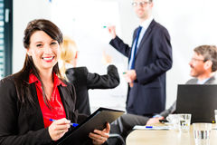 Business - businesspeople have team meeting. Business - businesspeople have a meeting with presentation in office, they negotiate a contract - Portrait of a stock photography