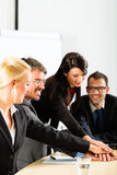 Business - businesspeople have team meeting. Or workshop in an office and joining hands, it is a very good team royalty free stock photography