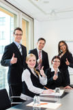 Business - businesspeople have team meeting in an office Stock Image