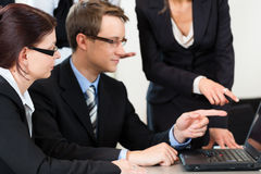 Business - businesspeople have team meeting in an office Stock Images