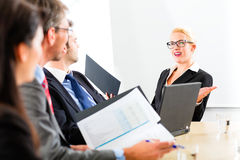 Business - businesspeople have team meeting. Business - businesspeople have a meeting with presentation in office, they negotiate a contract royalty free stock image