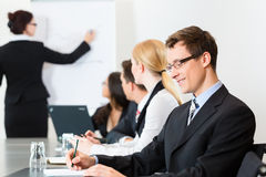 Business - businesspeople, meeting and presentation in office Stock Photos
