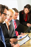 Business - businesspeople, meeting and presentation in office Stock Photo