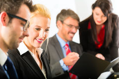 Business - businesspeople, meeting and presentation in office Stock Photography