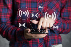 Business button WiFi interface web communication smartphone Royalty Free Stock Image