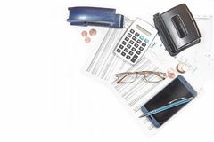 Business calculation with number tables, calculator, glasses, sm stock photos
