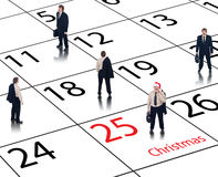 Business calendar for the holidays. Corporate business calendar for Christmas and the holidays with happy employees Stock Photography