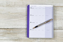 Business Calendar and Pen on old white wood Stock Photo