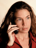Business call. A beautiful and serious business woman on a portable phone royalty free stock images